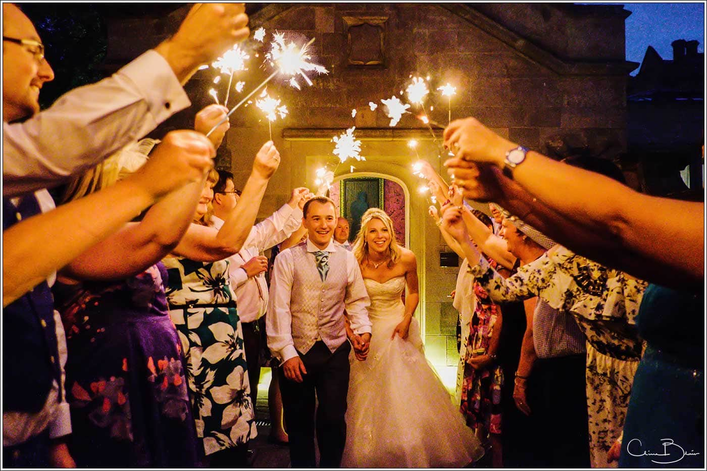 Sparkler exit for bride and groom-by Hampton manor documentary wedding photographer Birmingham Clive Blair Photography
