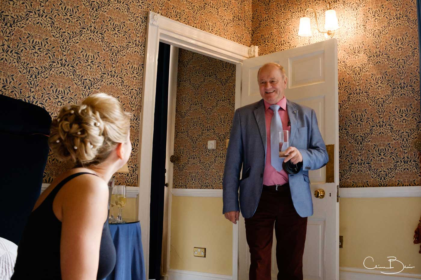 Father of bride seeing his daughter in the morning at Grafton Manor