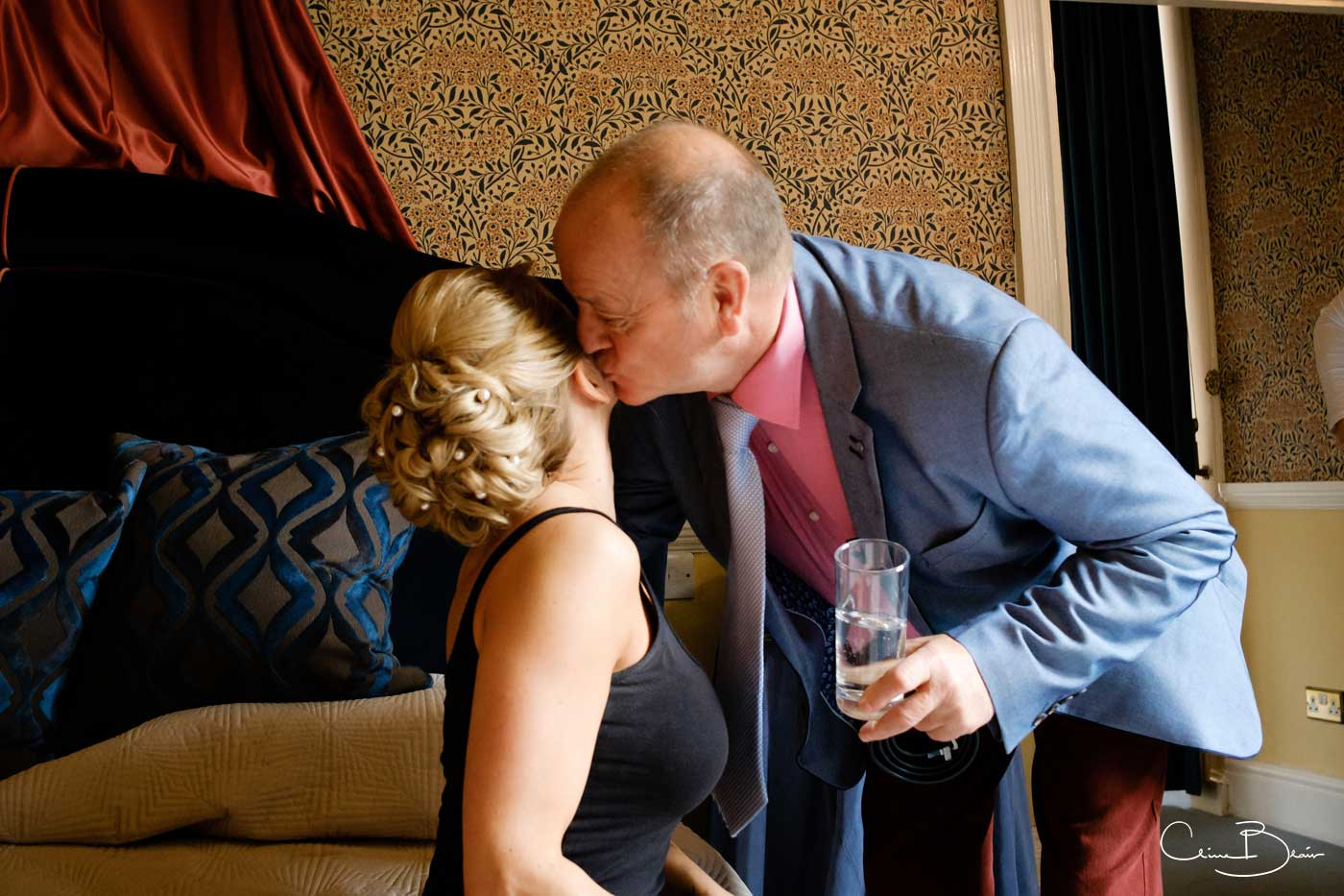 Father kissing his daughter before her Grafton Manor wedding