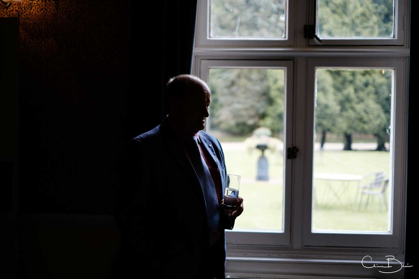 Father of bride in silhouette by Grafton Manor wedding photographer Clive Blair Pphotography