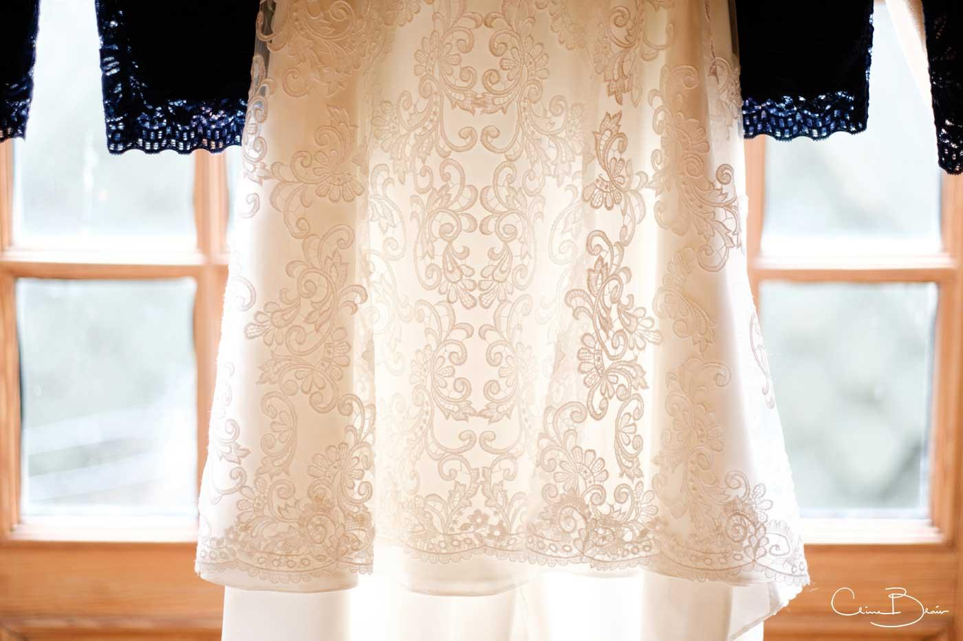 Bride's dress hung up at Grafton Manor