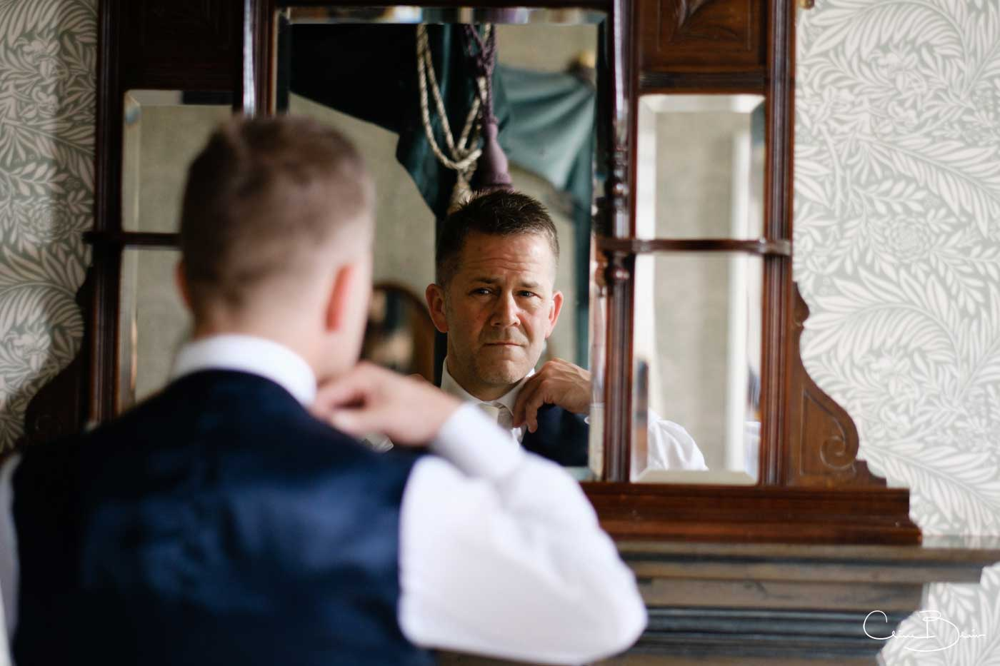 Anxious groom getting prepared at Grafton Manor