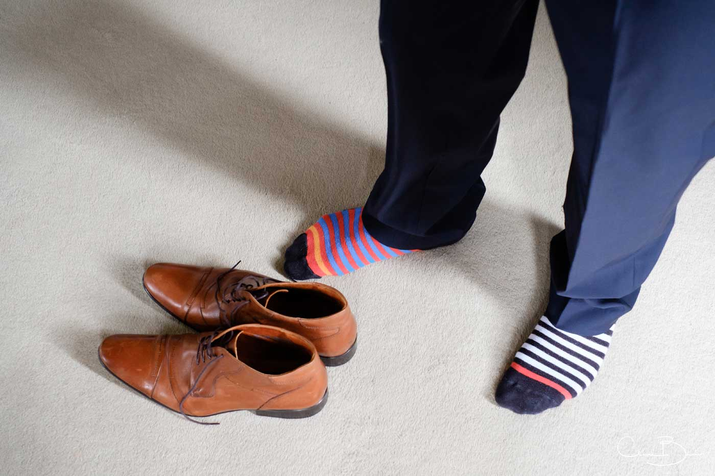 Groom with odd socks as captured by Grafton Manor wedding photographer Clive Blair Photography