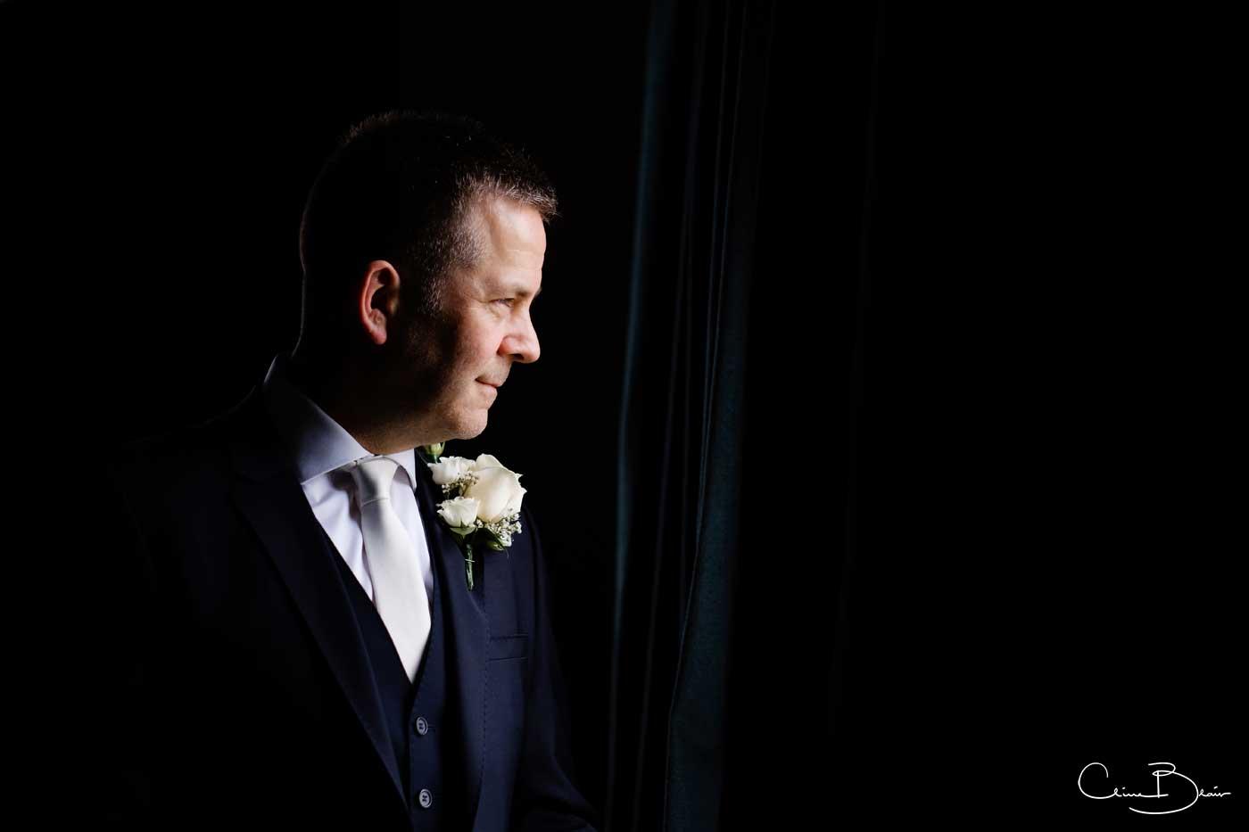 Groom in profile before his Grafton Manor wedding ceremony
