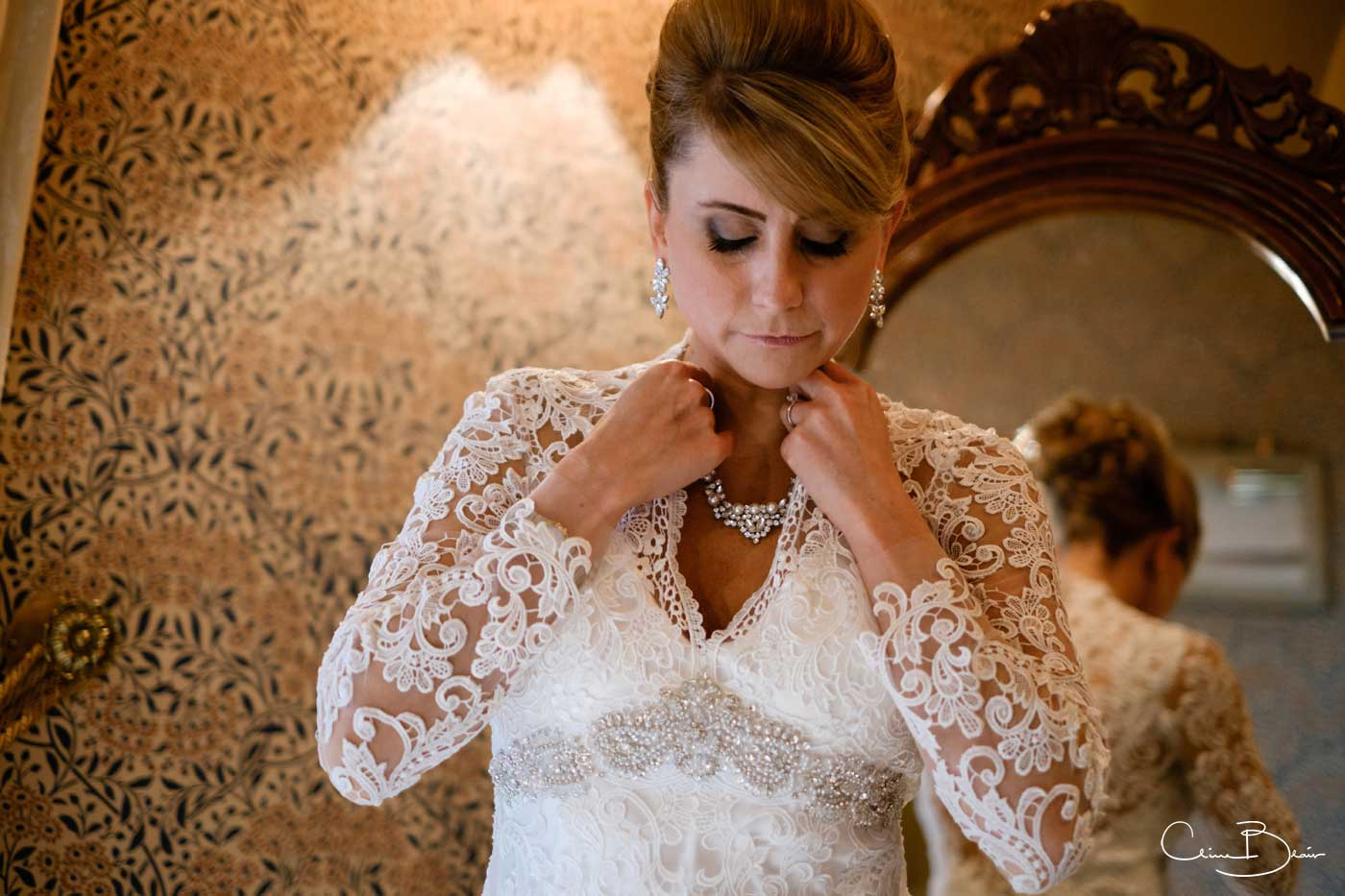 Bride making her finishing touches before her Grafton Manor wedding
