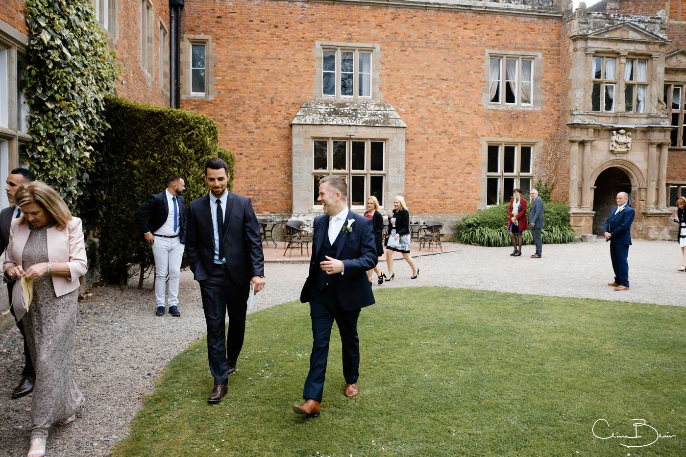 Groom walking to Grafton Manor chapel for his wedding ceremony by Grafton Manor wedding photographer Clive Blair Photography