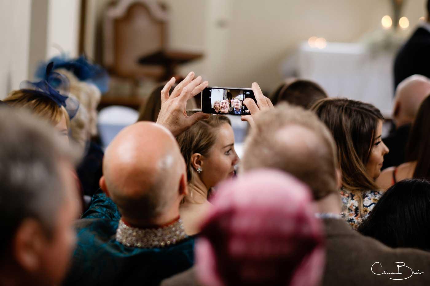 Wedding guest taking a selfie before ta Grafton Manor wedding ceremony