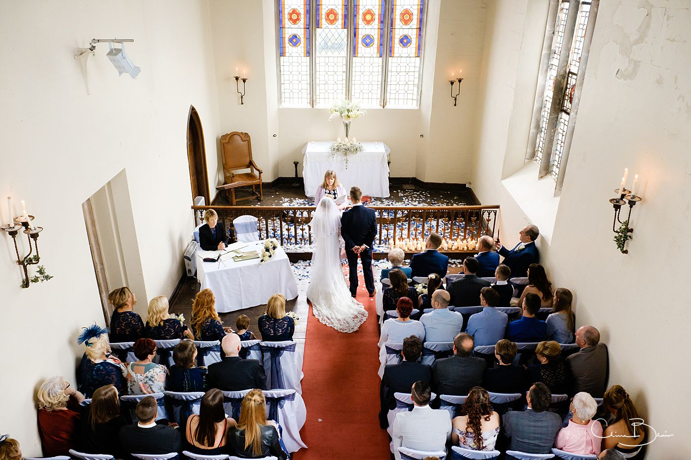 Bride and groom during their wedding ceremony at Grafton Manor chapel