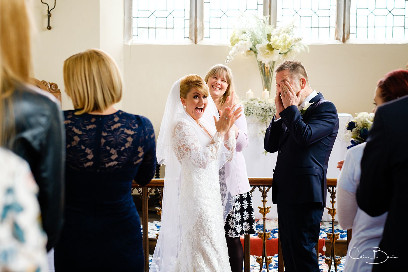 Jubilant bride and groom after their wedding ceremony at Grafton Manor chapel