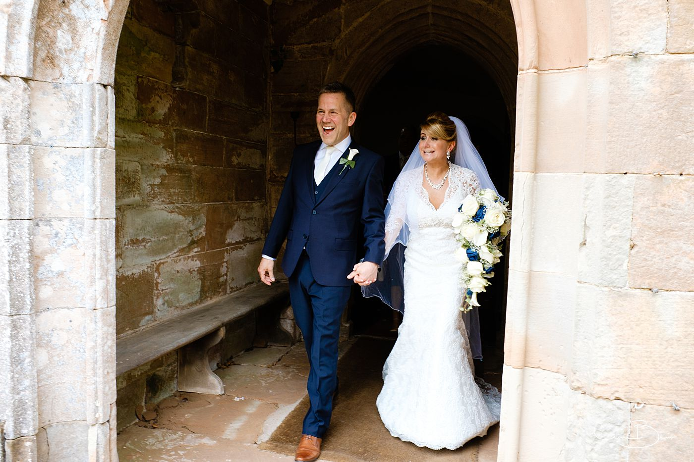 Bride and groom exiting Grafton Manor wedding chapel