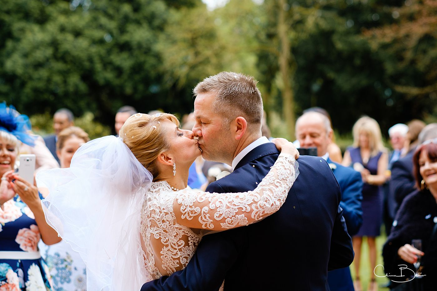 Kissing bride and groom at Grafton Manor