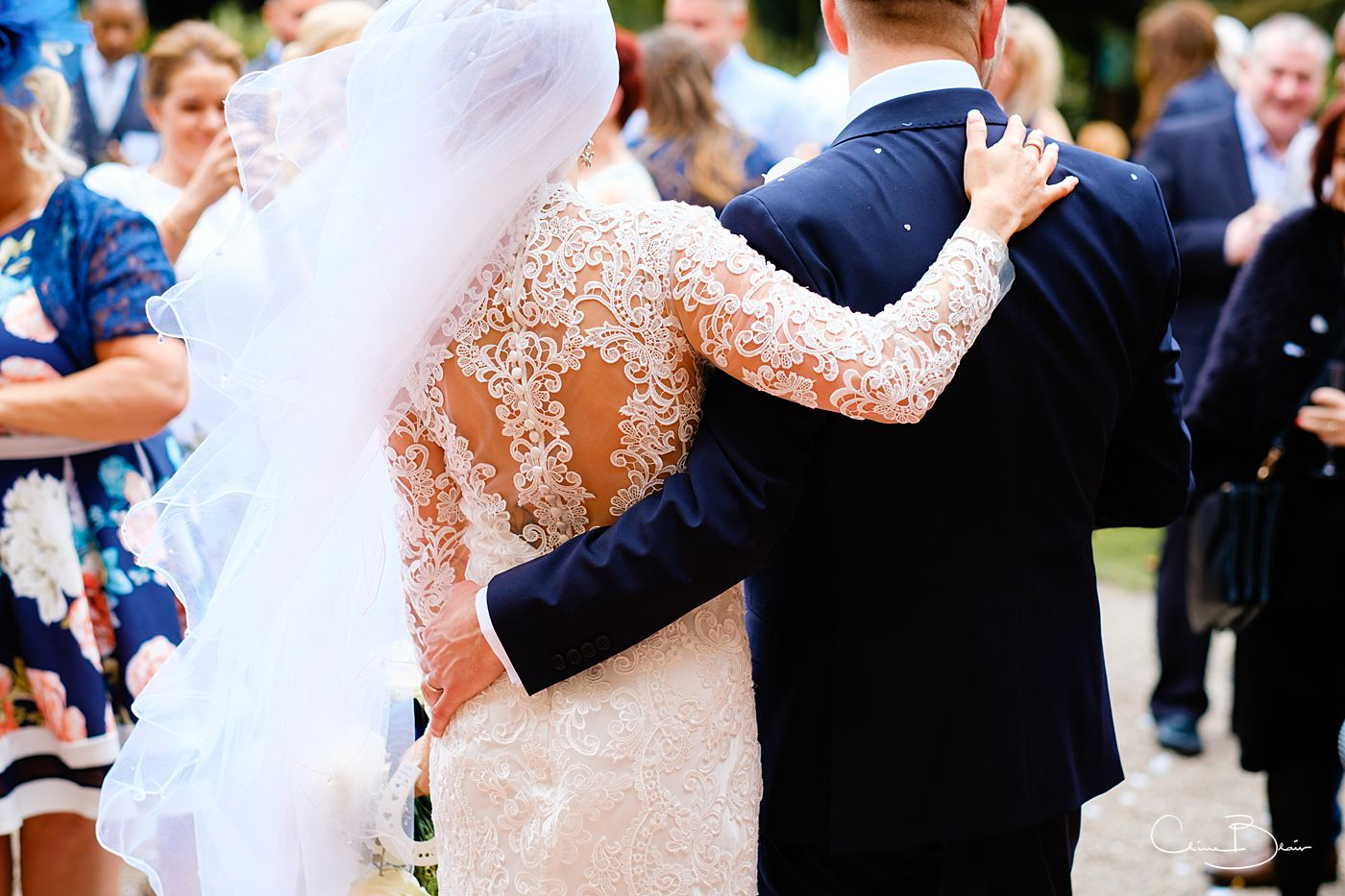 Bride and groom hugging after their Grafton Manor wedding ceremony