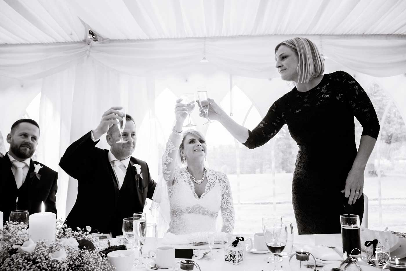 Toasting during the speeches at Grafton Manor wedding breakfast
