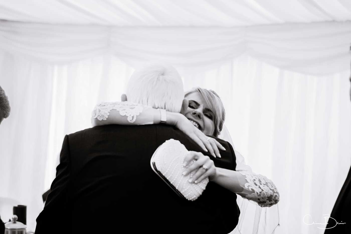 Bride hugging guest at Grafton Manor