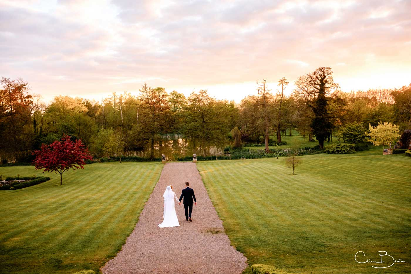 Bride and groom walking together in the grounds of Grafton Manor
