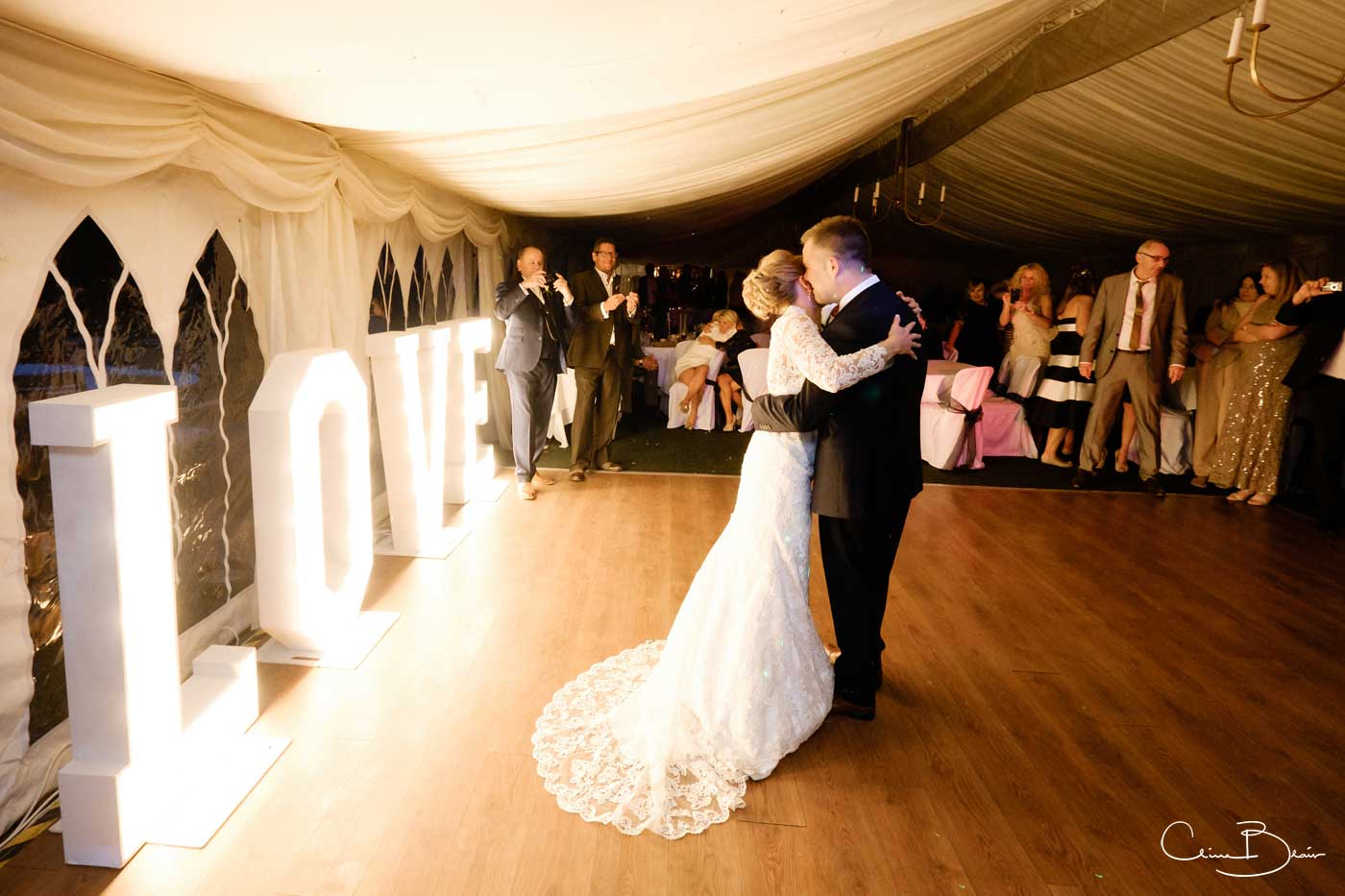 Bride and groom on dance floor during their first dance at Grafton Manor