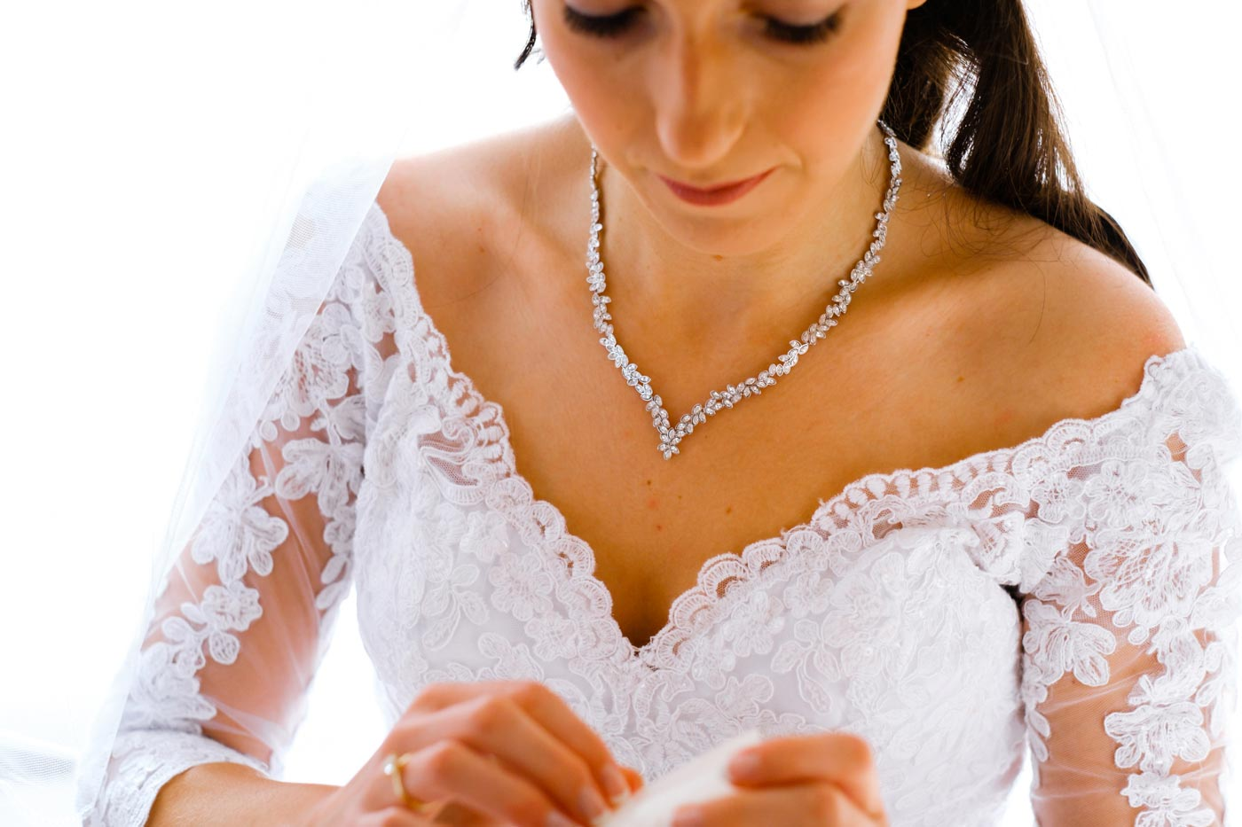 Close-up of bride while getting ready