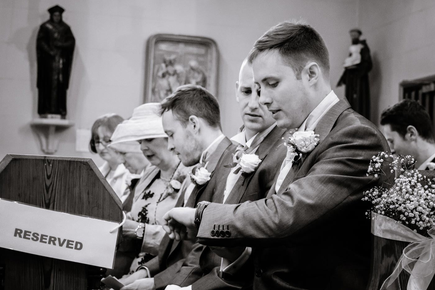 Groom checking his watch by documentay wedding photographer Birmingham Clive Blair Photography