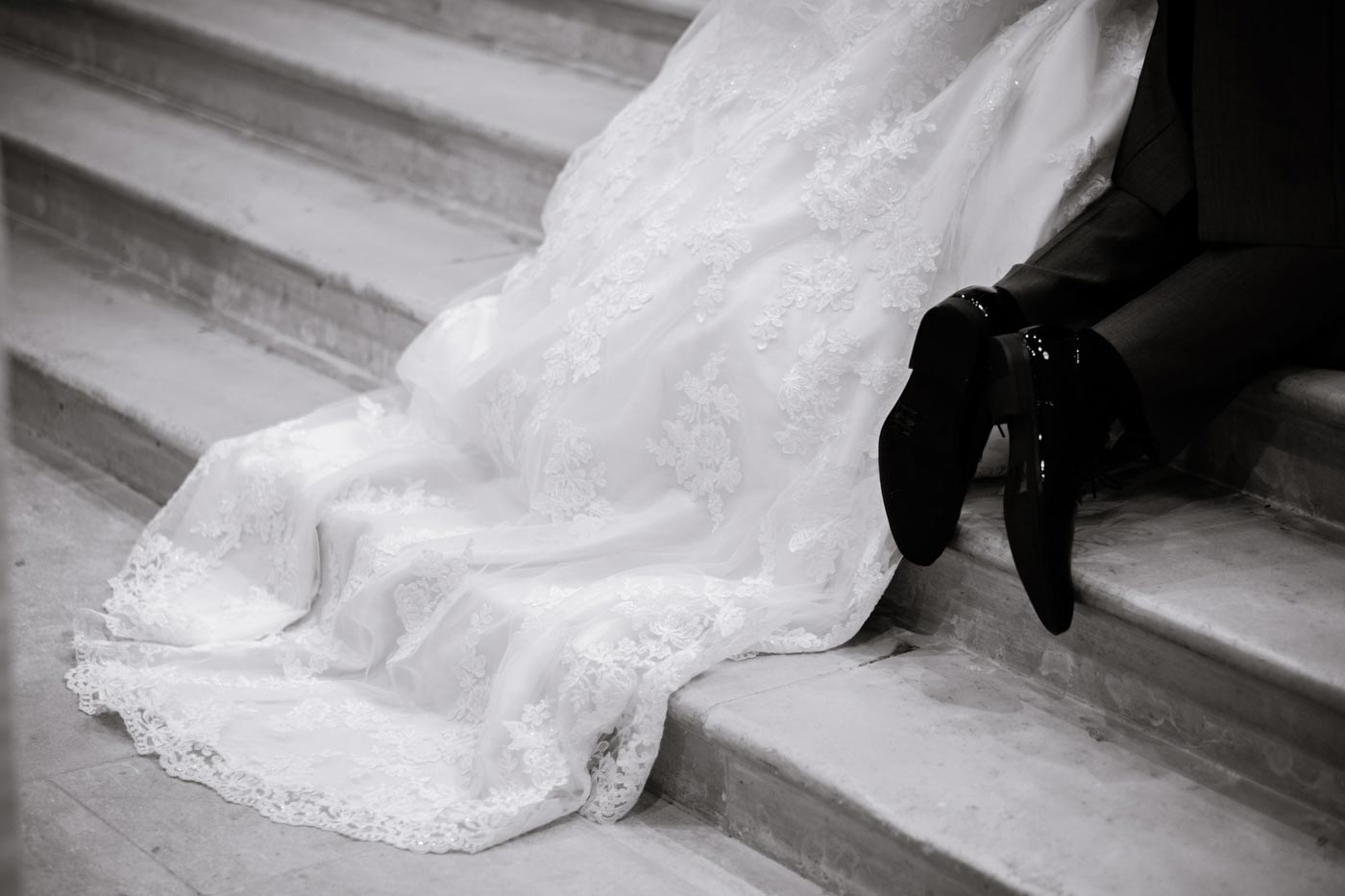 Close-up of bride's dress sloping down alter steps