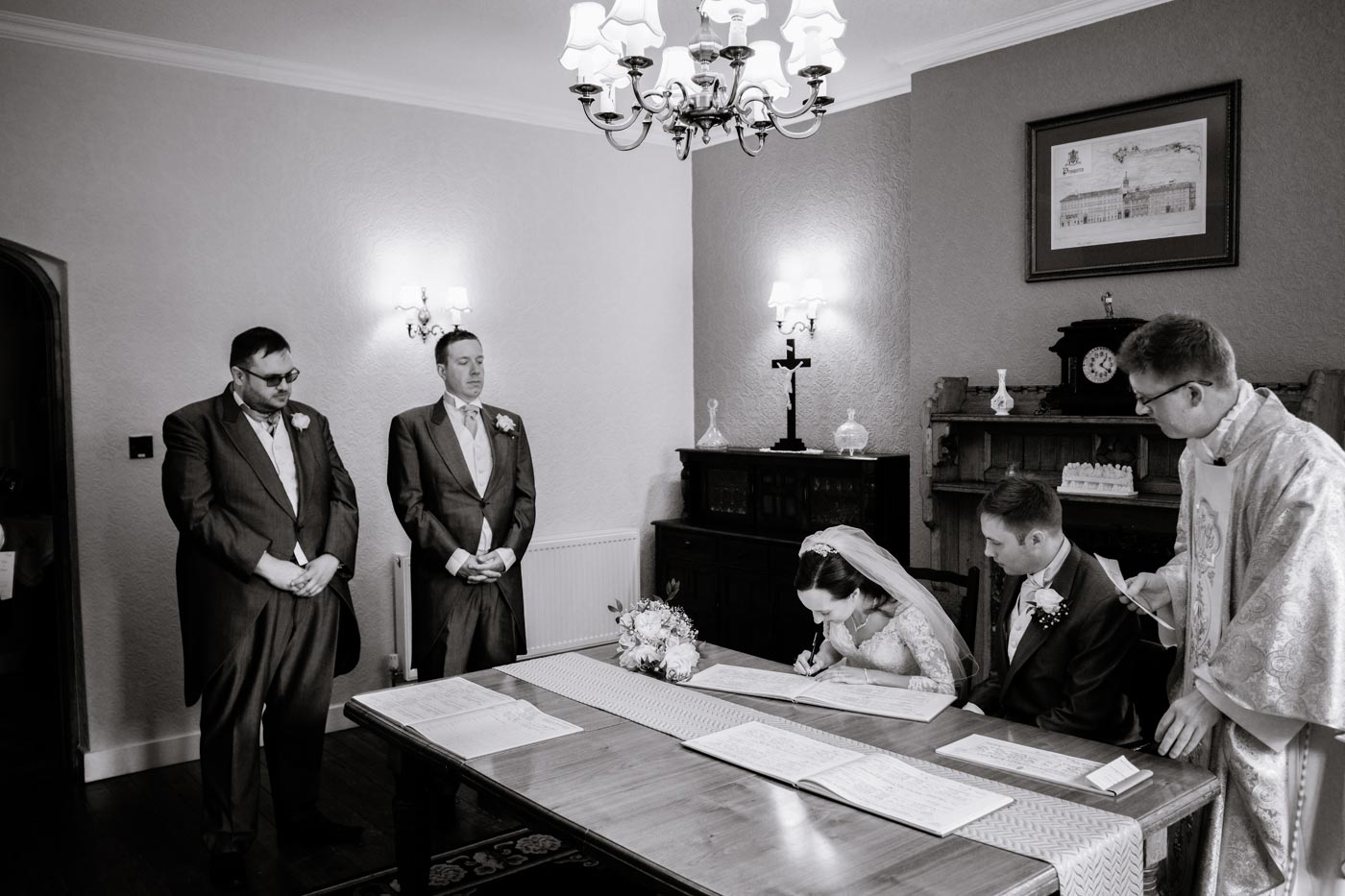 Groom and bride signing the register by documentay wedding photographer Birmingham Clive Blair Photography