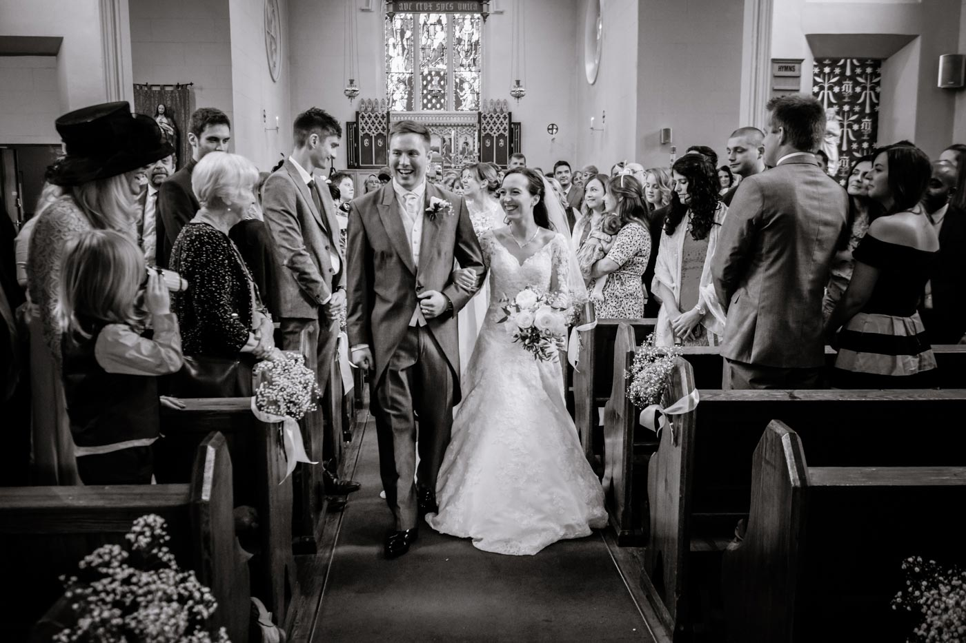 Bride and groom walking down the aisle by documentay wedding photographer Birmingham Clive Blair Photography