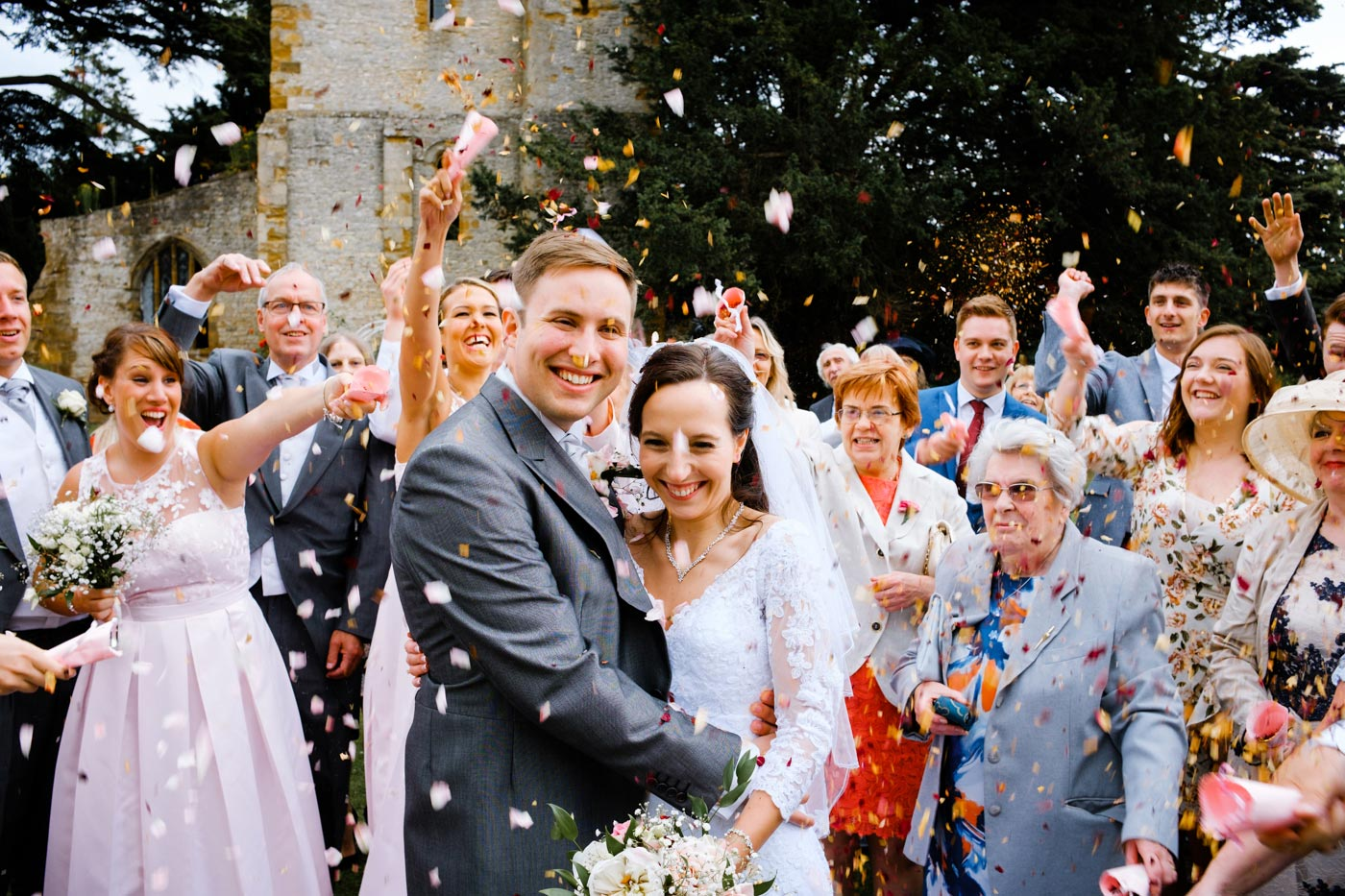 Confetti in front of The Bell Tower at Ettington Park Hotel