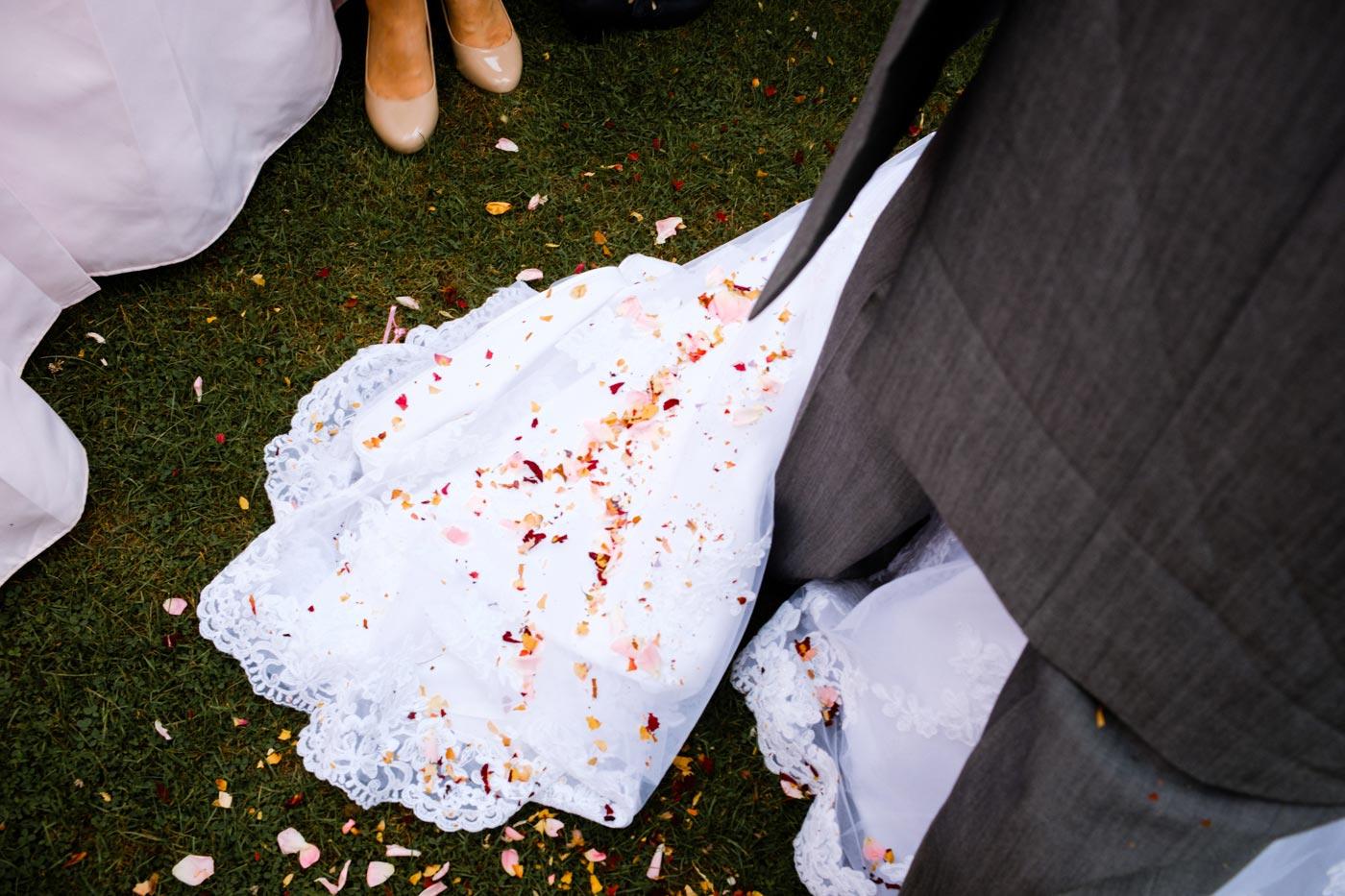 Confetti on the bride's dress at Ettington Park Hotel