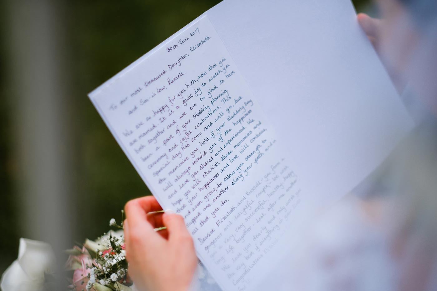 Bride and groom reading special letter from Bride's parents during their Ettington Park Hotel wedding