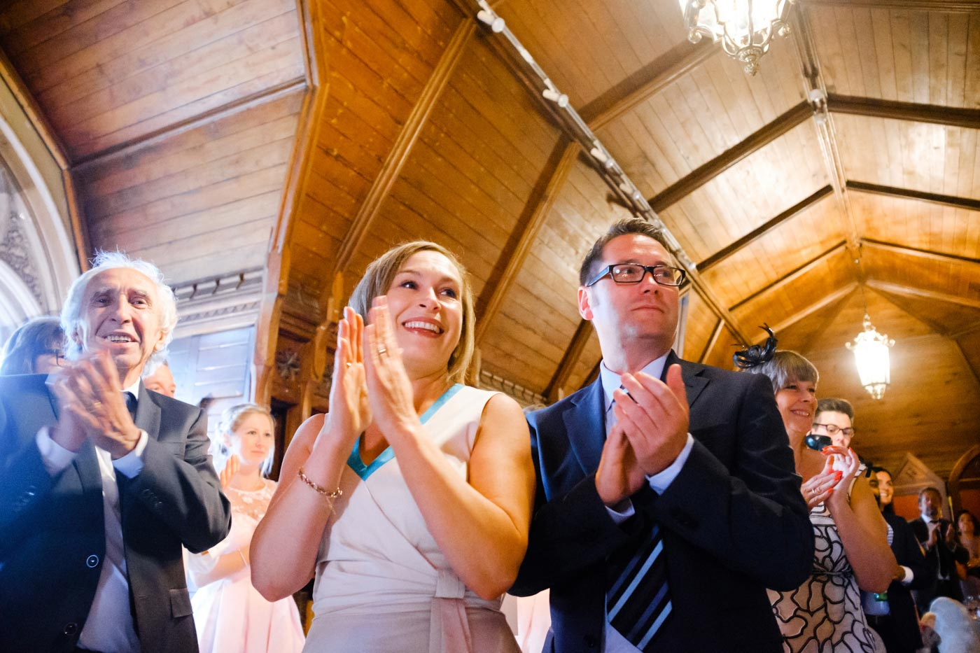 Guests welcoming the bride and groom as they enter the wedding breakfast room at Ettington Park Hotel