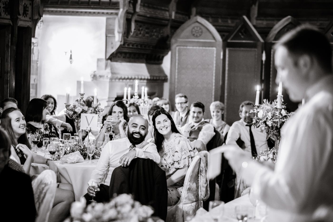 Guests laughing during groom's speech at Ettington Park Hotel