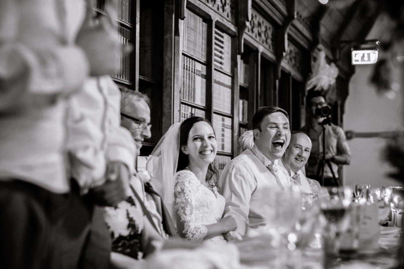 Groom laughing at best man's speech