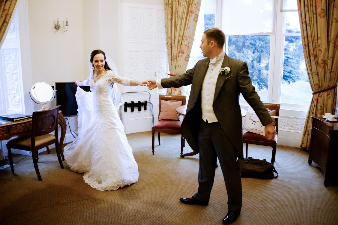 Bride and groom practising their first dance