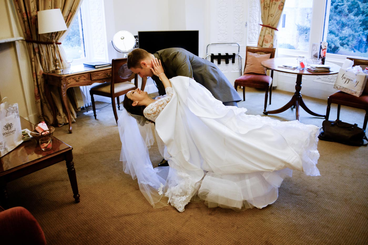 Groom and bride practising their first dance at Ettington Park Hotel