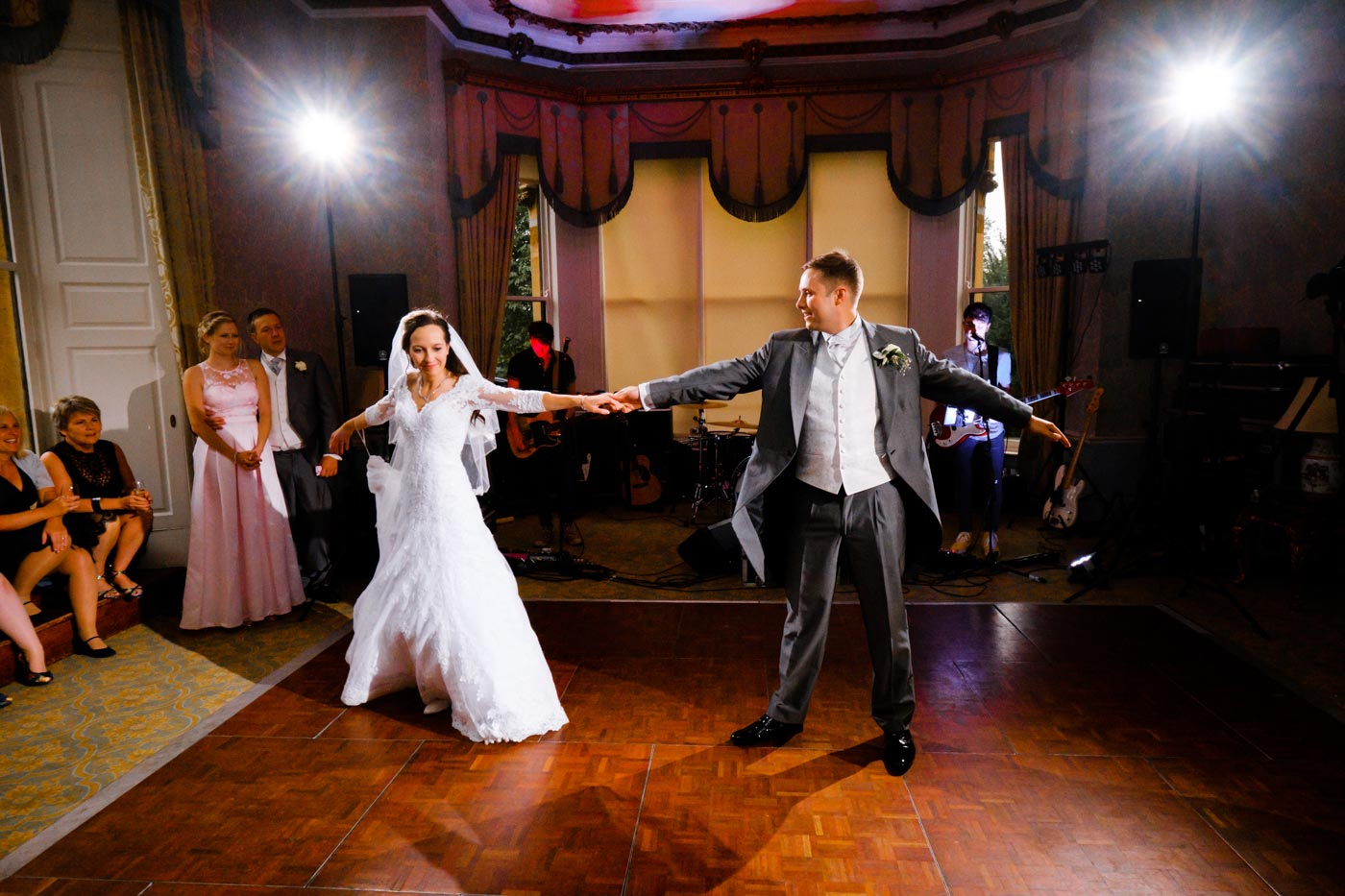 Bride and groom dancing at Ettington Park Hotel