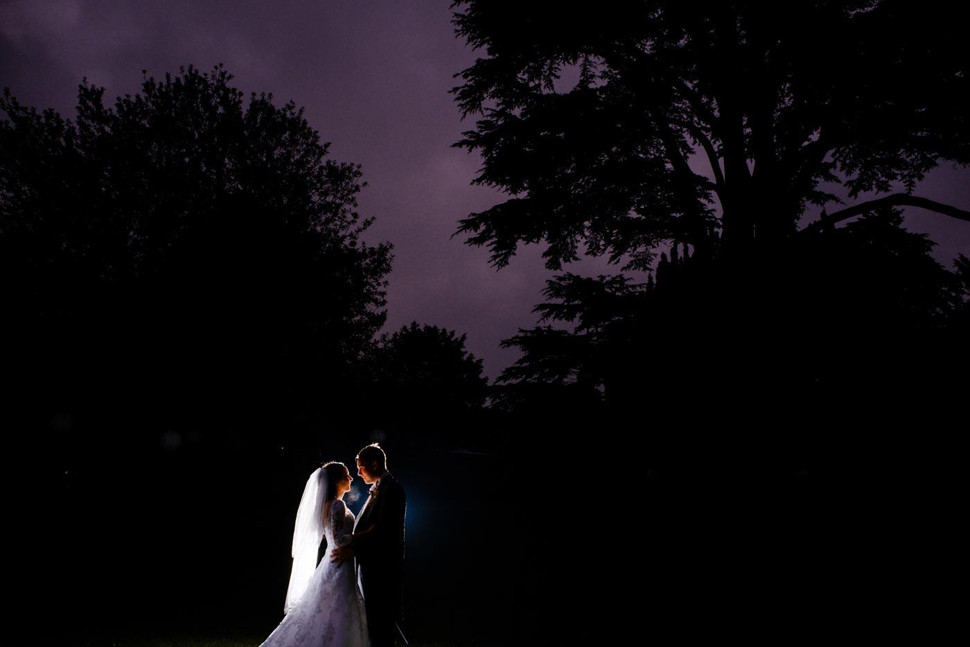Bride and groom backlit at Ettington Park Hotel