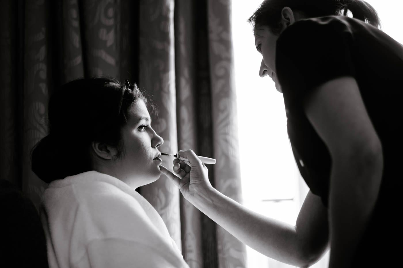 Bride having her make-up done as photographed by lake District wedding photographer Clive Blair Photography