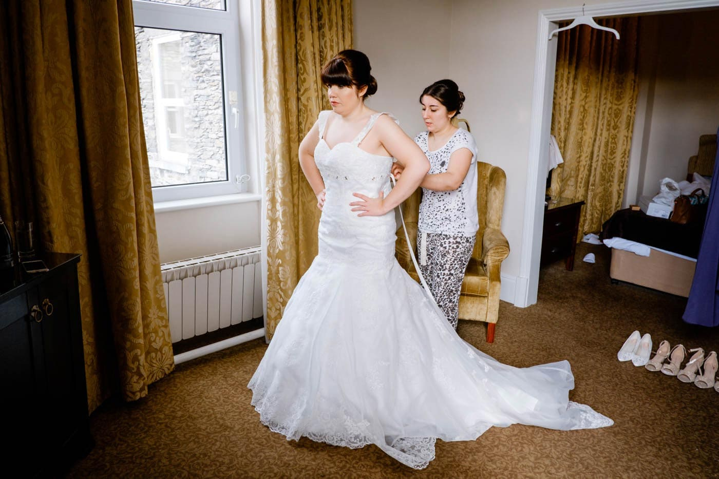 Bride helped my maid with wedding dress