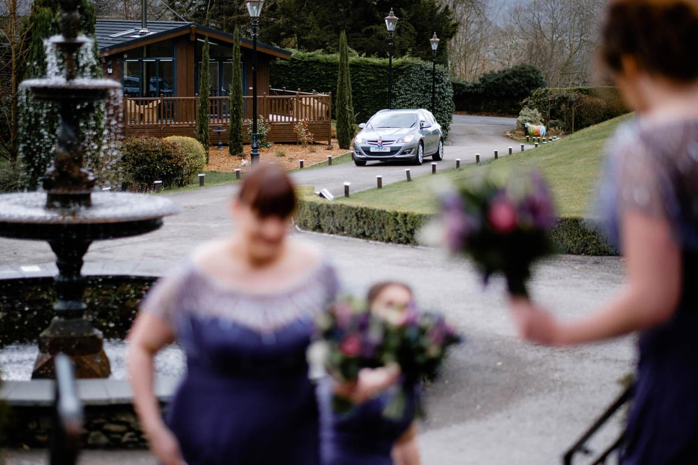 Bride's car arriving for her wedding ceremony at Broadoaks Country House by Lake District wedding photographer Clive Blair Photography