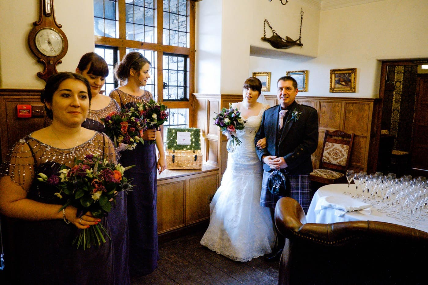 Bride, father and maids waiting inside Broadoaks Country House before the wedding ceremony