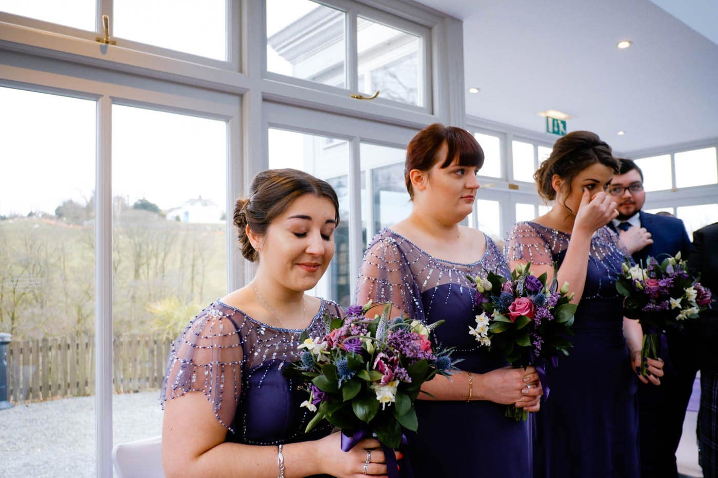 Emotional maids during the wedding ceremony at Broadoaks Country House