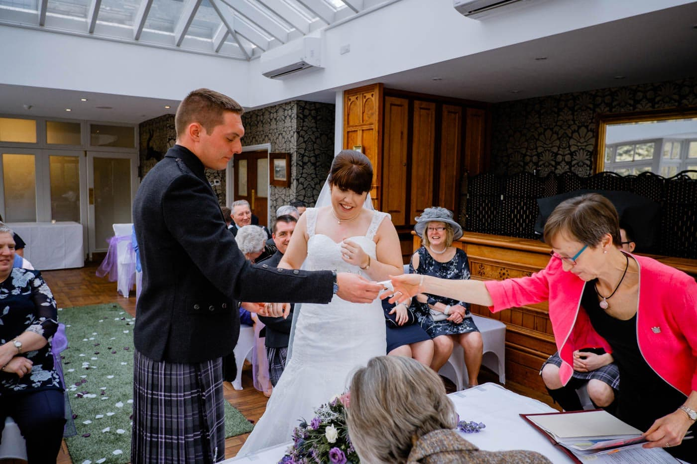 Groom being handed tisue to wipe away his tears during his Lake District wedding ceremony by Lake District wedding photographer Clive Blair Photography