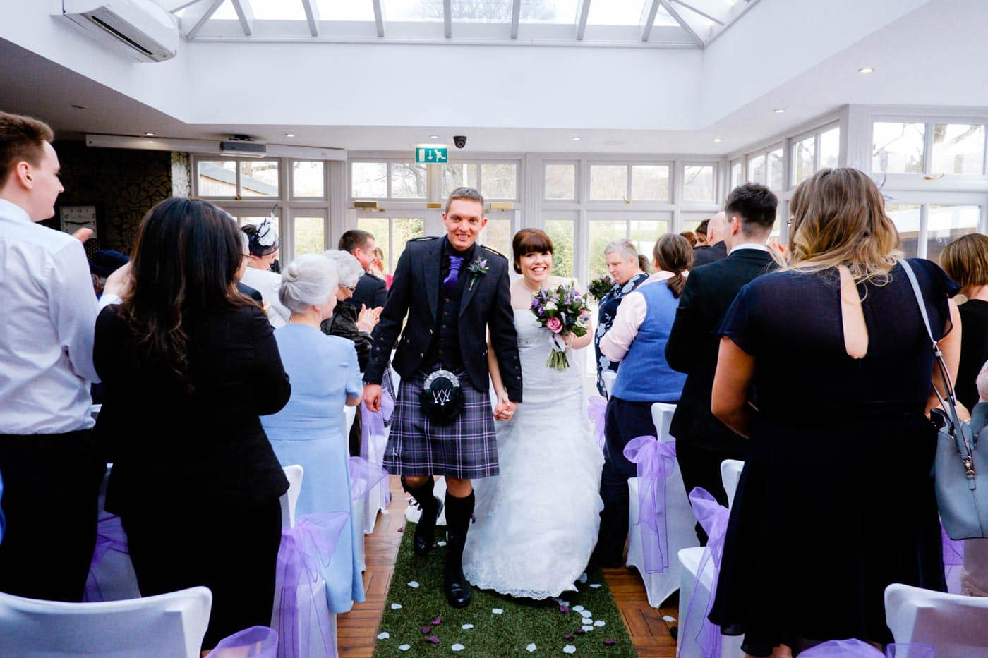 Scottish bride and groom walking down the aisle at Broadoaks Country House