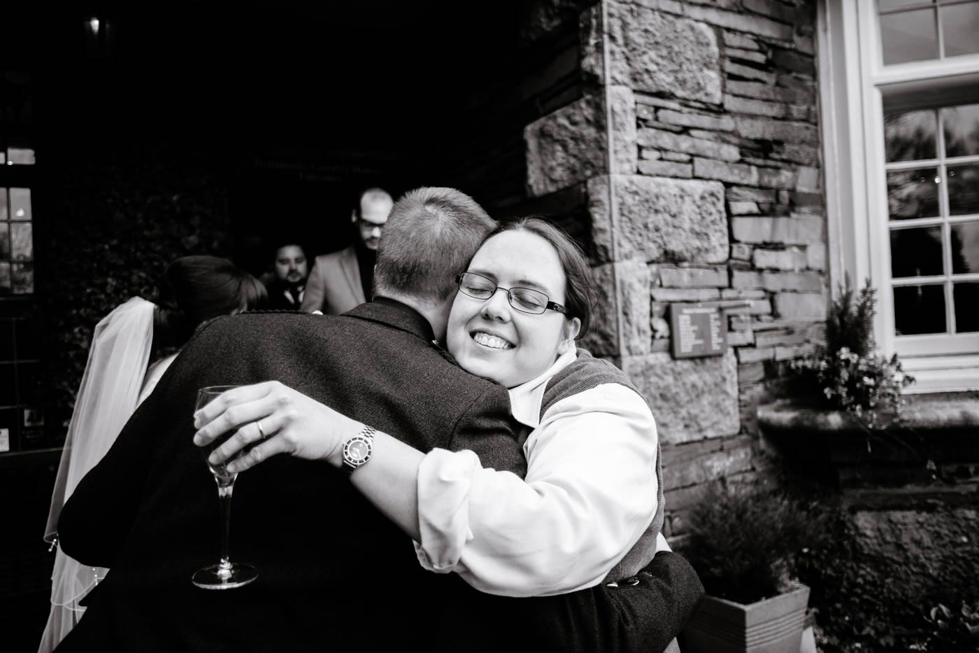 Guest hugging groom after the wedding ceremony at Broadoaks Country House
