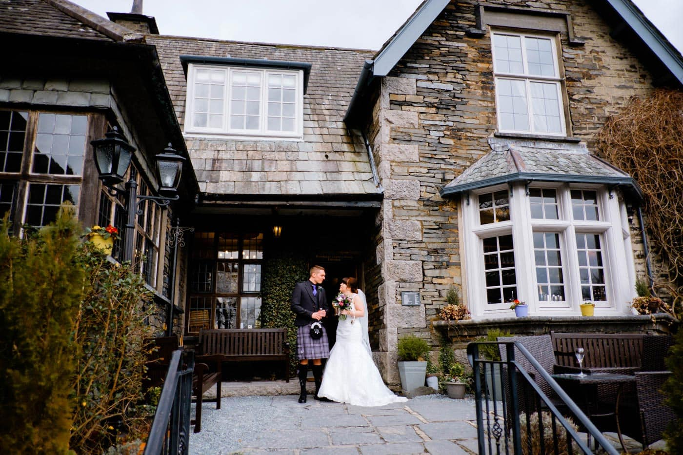 Scottish bride and groom waiting outside Broadoaks Country House by Lake District wedding photographer Clive Blair Photography