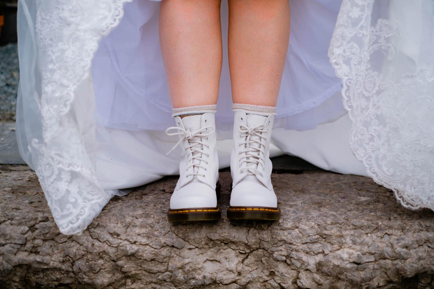 Bride wearing white Doc Marten's boots