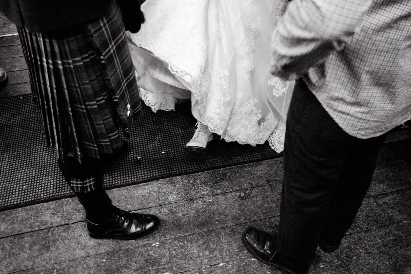 Bride showing off her white Doc Marten's boots