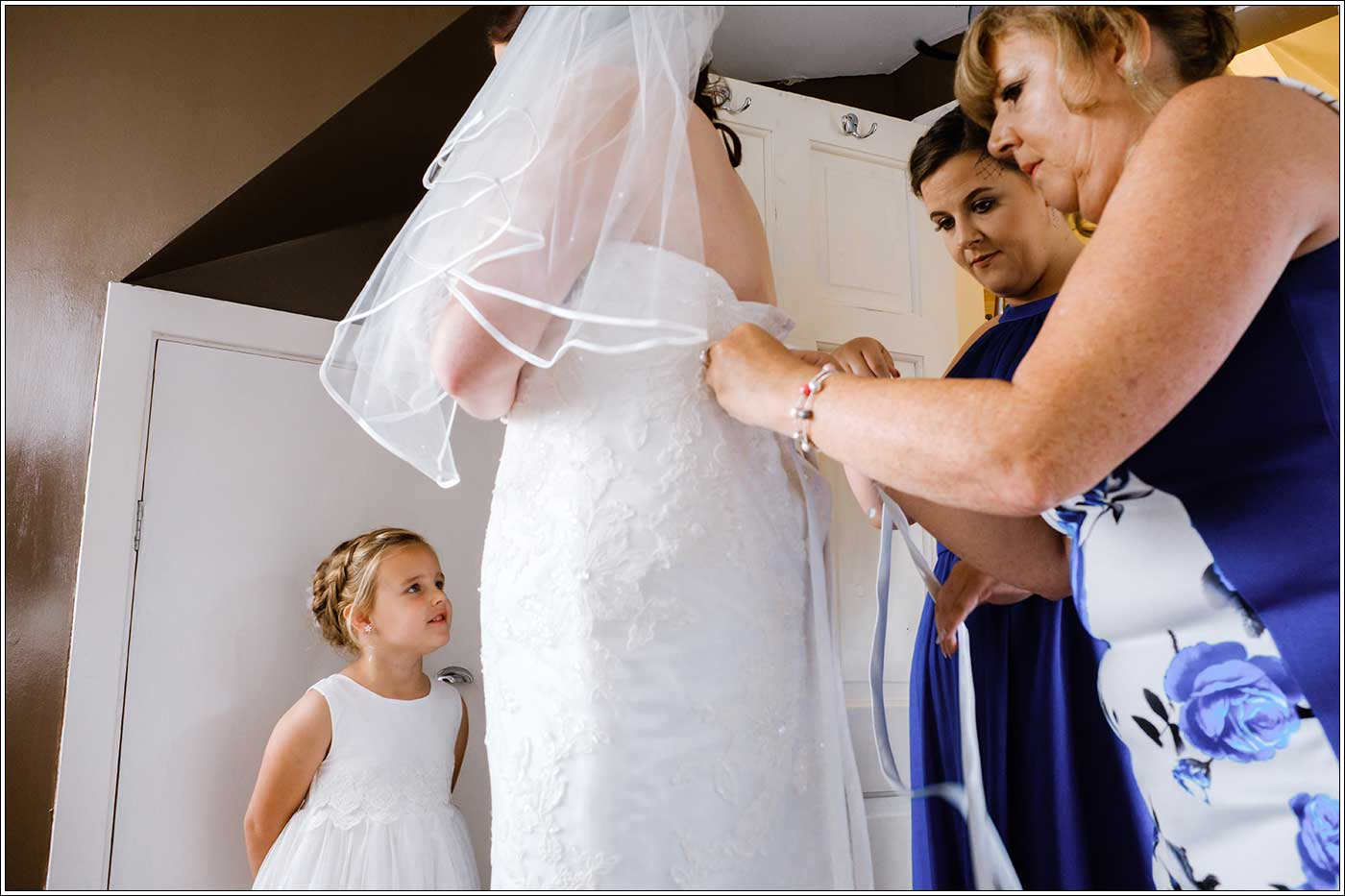 Bride getting ready with maids and her mother before her Park Hall Farm wedding