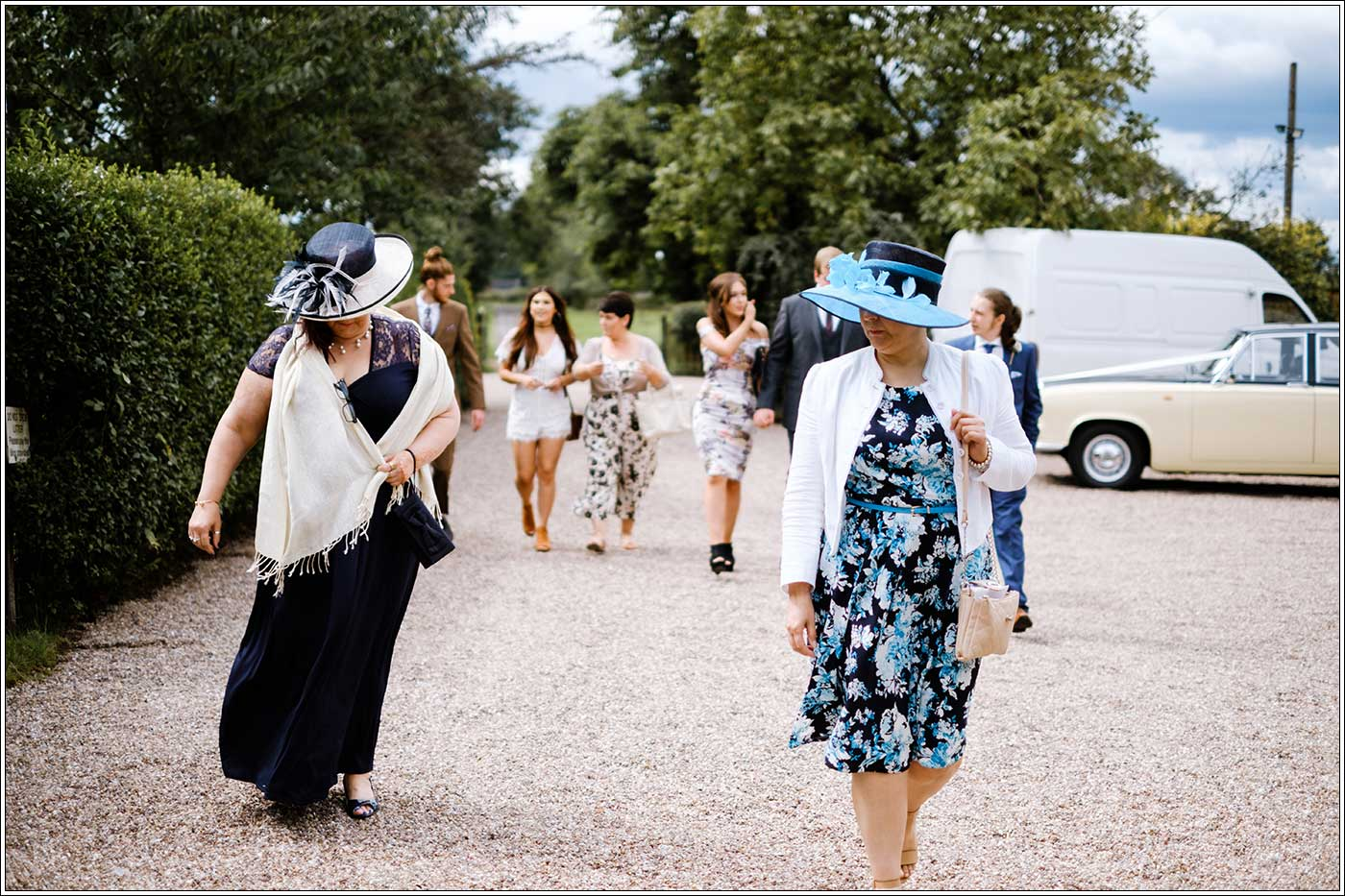 Guest arriving at a Park Hall Farm wedding by documentary wedding photographer Birmingham Clive Blair Photography