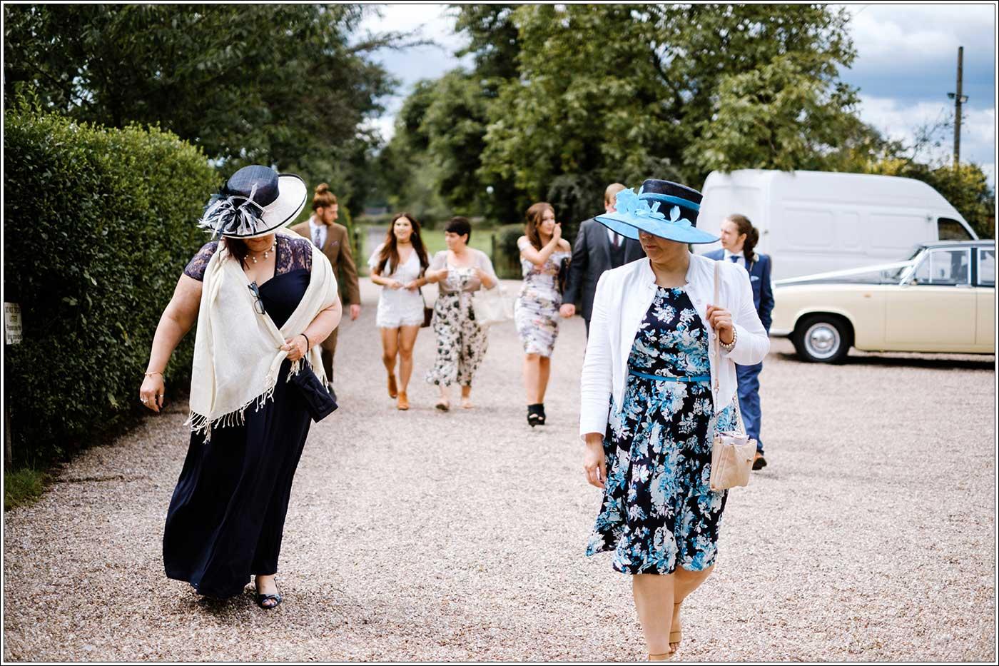 Guest arriving at a Park Hall Farm wedding by documentary wedding photographer Birmingham Clive Blair Photography