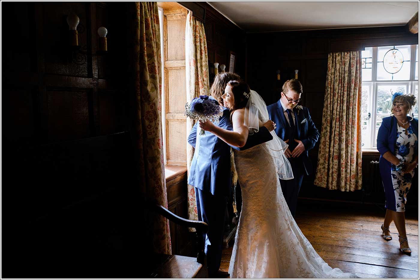 Bride hugging before her wedding